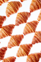Diagonal baked goods pattern on a light background.
