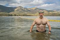 open water swimming in mountain lake