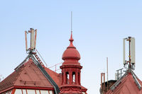 Telecommunication antennas on the reed roof of a house in historical center of city Prague, Czech re