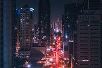 city lights at night - modern city traffic aerial