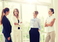 business women meeting at office and talking