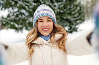 smiling woman taking selfie outdoors in winter