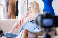 Fashion blogger recording new video for her vlog
