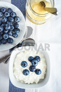 Whole raw blueberries with cottage cheese and lemon curd. Light and healthy breakfast or snack.