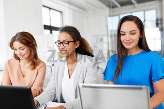 businesswomen with laptops working at office