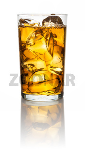 A glass with iced tea and icecubes on a white background