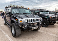 Black luxury cars Hummer parking at the city street