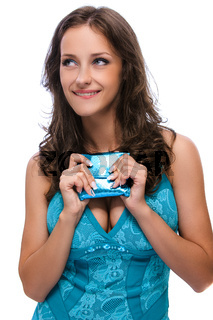smiling beautiful woman with dark hair in blue dress with purse