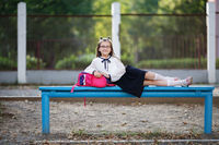 Schoolgirl resting on a bench