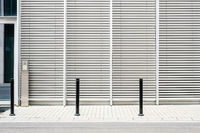 empty sidewalk with modern building background with closed venetian blinds