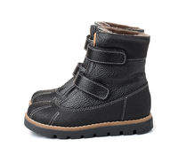 Pair of child winter leather shoes