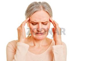 Alte Frau mit Kopfschmerzen