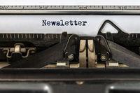 Vintage typewriter with word newsletter