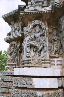 Ornate wall panel reliefs depicting Krishna dancing on the head of serpant Kalia and eventually killing him. Kedareshwara temple, Halebidu, Karnataka