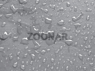 water drops on quiet gray colored metallic surface
