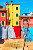 Colorful houses and clothes in Burano