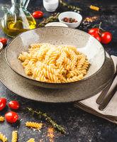 Cooked fusilli pasta in plate