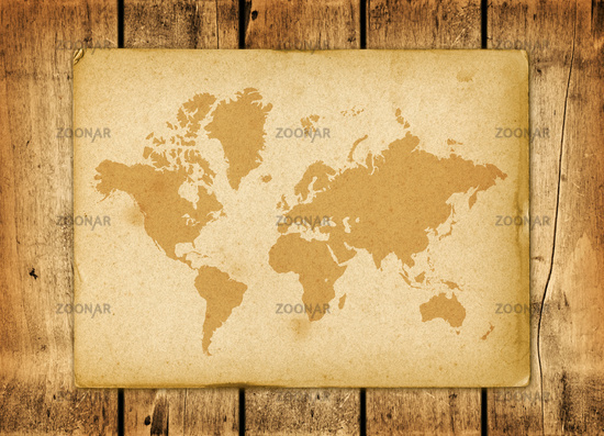 Vintage world map parchment on a wooden wall