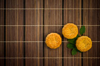 Top down mooncakes on bamboo mat with copy space
