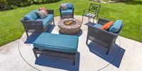 Circular fire pit and chairs on a sunny backyard