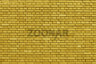 Ceylon Yellow colored brick wall background