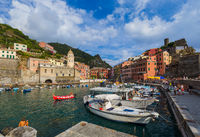 VERNAZZA, ITALY - AUGUST 17, 2016: Tourists walk by Vernazza in Cinque Terre on August 17, 2016 in Vernazza Italy