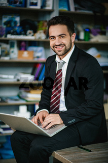 Happy business man working on a business project