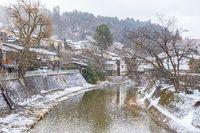 Takayama old town with snow falling in Gifu, Japan