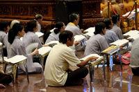 Vietnamese Buddhists read prayer