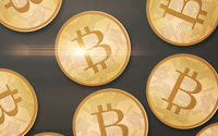 gold bitcoins over gray background from top
