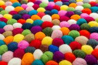 Multicolored felt ball rug detail