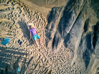 Man in lounger on a beach aerial view