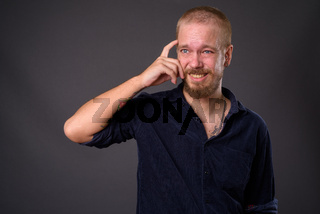 Portrait of man against gray studio background
