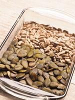 Organic pumpkin and sunflower seeds in a bowl