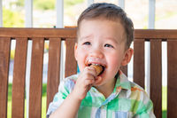 Young Mixed Race Chinese and Caucasian Boy Enjoying His Ice Cream Cone