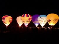 The glow of hot air balloons at night during the World Ploughing Competition in Germany 2018