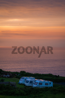 Caravans on a camping site at dusk