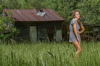 Lovely Brunette Model Posing Outdoors In A Rural Environment