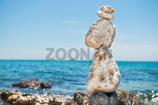 Zen stones balance at sea background