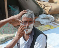 Shaving with a straight razor in India