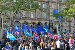 a large crowd with flags and banners at the leeds for europe anti brexit demonstration