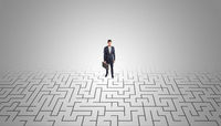 Businessman standing in a middle of a maze