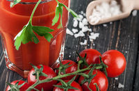 Closeup of tomato juice and cherry tomatoes