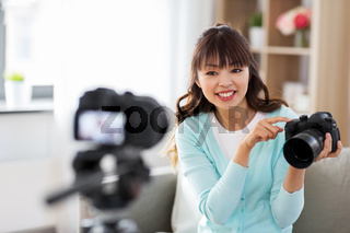 asian female blogger with camera recording video