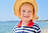 Toddler boy on beach
