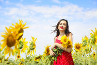 Pretty brunette woman in sunflower field
