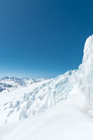Winter snow covered mountain peaks in Caucasus. Great place for winter sports