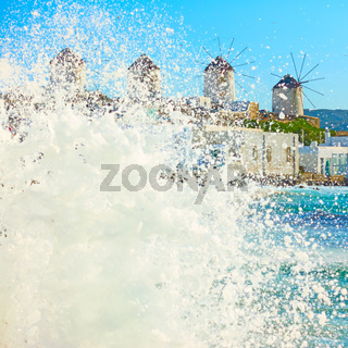 Sea surf and windmillls in Mykonos