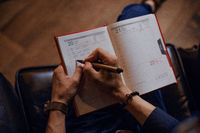 Man taking notes in a notebook