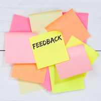 Feedback contact customer service opinion survey review business concept desk note paper